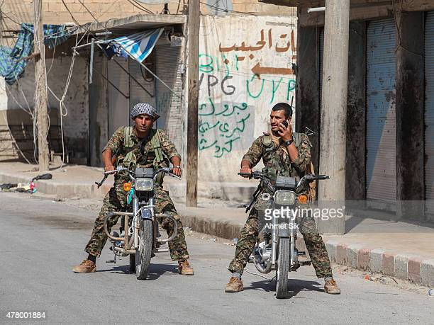 Kurdish People's Protection Units or YPG fighters controls the central Tal Abyad Syria June 19 2015 Kurdish fighters with the YPG took full control...
