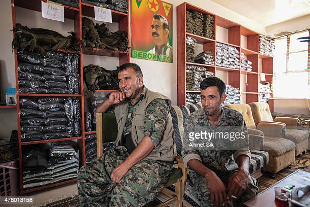 Kurdish People's Protection Units or YPG fighters rest in a base camp in the destroyed Syrian town of Kobane also known as Ain alArab Syria June 20...