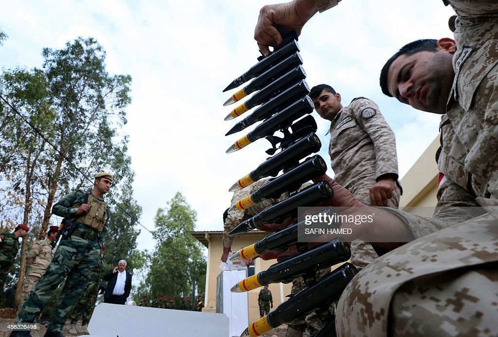 A Kurdish peshmerga fighter holds ammunition during a training session at their camp on November 3 2014 in Arbil the capital of the autonomous...