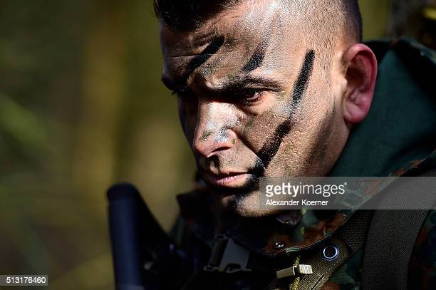 A Kurdish peshmerga fighter looks on during a Bundeswehr training session on March 1 2016 in Munster Germany The Bundeswehr is supporting Kurdish...