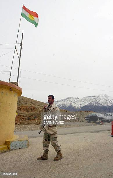 A Kurdish Peshmerga fighter stands guard at a checkpoint near the IraqTurkey border in northern Iraq's Kurdistan region on February 24 2008 The...