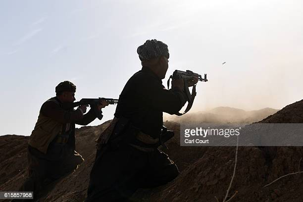 Kurdish peshmerga fighters fire at an ISIS position during an assault to recapture the village of Tiskharab on October 20 2016 near Mosul Iraq...