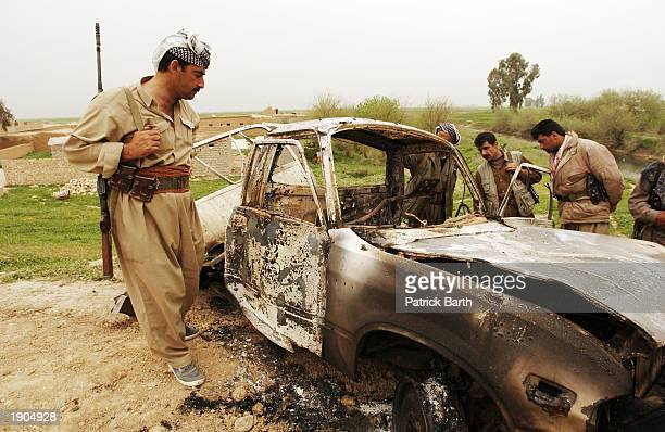 Kurdish Peshmerga fighters look over a bombed car April 6 2003 in Hauera northern Iraq US Special Forces who have been in northern Iraq in small...