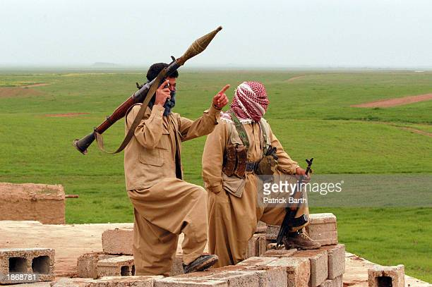 Kurdish Peshmerga fighters man an observation post as they ready and wait for an imminent attack by the Iraqi army at the last frontline before...
