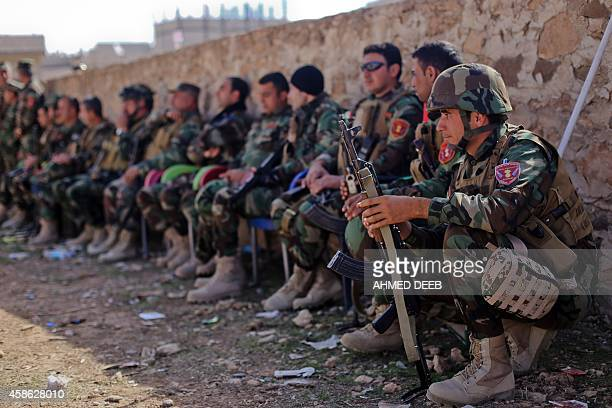 Kurdish Peshmerga fighters rest during fighting against Islamic State group on November 8 2014 in the Syrian besieged border town of Ain alArab USled...