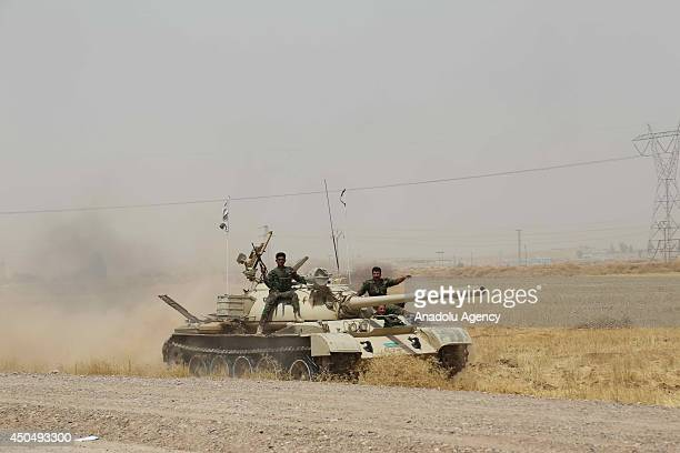 Kurdish Peshmerga forces and Iraqi special forces deploy their troops and armoured vehicles outside of the oilrich city of Kirkuk Iraq on June 12...