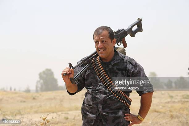 Kurdish Peshmerga forces and Iraqi special forces deploy their troops outside of the oilrich city of Kirkuk Iraq on June 12 2014 The hardline...