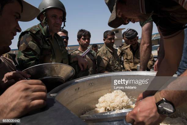 Kurdish Peshmerga forces are served lunch at a military base near the Khazir frontline in Northern Iraq August 16 2014 Since IS started making its...
