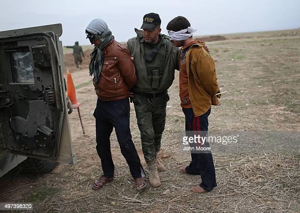 Kurdish Peshmerga forces detain suspected ISIL or Daesh who fled their frontline village to a Kurdishcontrolled area on November 16 2015 to Sinjar...