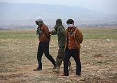 Kurdish Peshmerga forces detain suspected members of ISIL or Daesh in Arabic who mixed with a group of villagers fleeing the frontline to a...