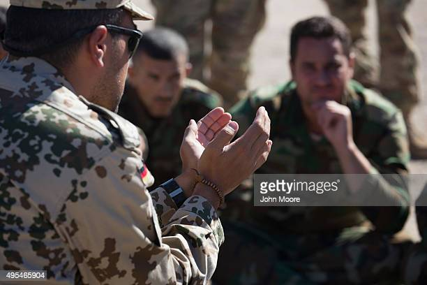 Kurdish Peshmerga forces learn battlefield first aid techniques from a German military doctor during a medical training session on November 3 2015 in...
