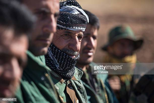 Kurdish Peshmerga forces listen during the last week of a military training course on November 3 2015 in Erbil Iraq The Kurdish troops many of them...