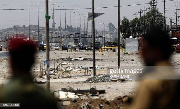Kurdish Peshmerga forces look at a checkpoint held by militants of the Islamic State of Iraq and the Levant jihadist group on June 16 2014 in Iraq's...