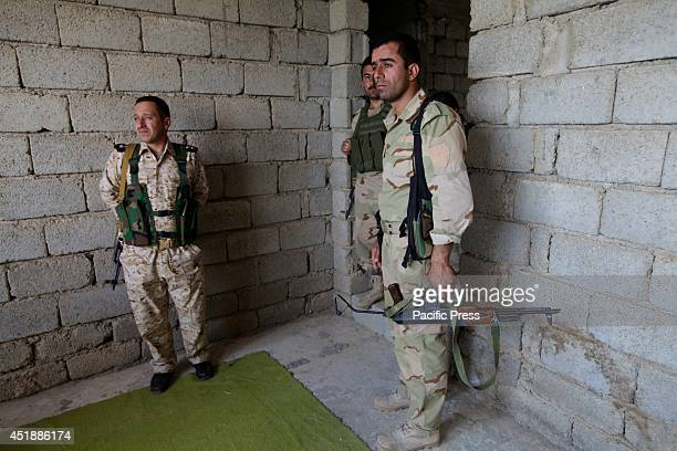 Kurdish Peshmerga forces on the outskirts of Mosul watch as a mortar fired by ISIS hits one of their vehicles they immediately rush in to reinforce...