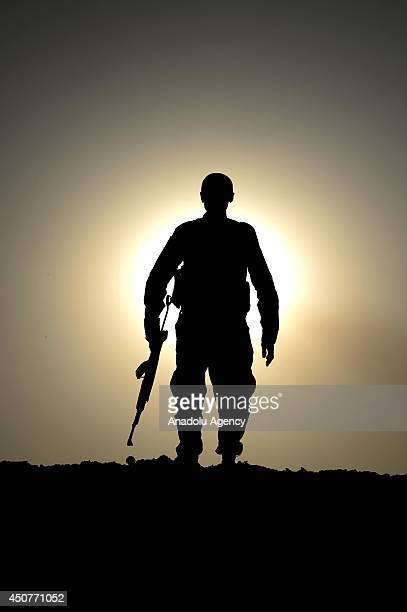 Kurdish Peshmerga forces stand guard in the oilrich city of Kirkuk against Islamic State of Iraq and the Levant on June 17 2014 Kurdish Peshmerga...