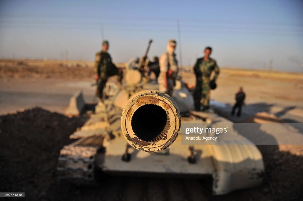 Kurdish Peshmerga forces stand guard in the oil-rich city of Kirkuk against Islamic State of Iraq and the Levant (ISIL) on June 17, 2014. Kurdish Peshmerga forces regained control of Kirkuk province on Wednesday, June 11, 2014 after the ISIL seized parts of the city.