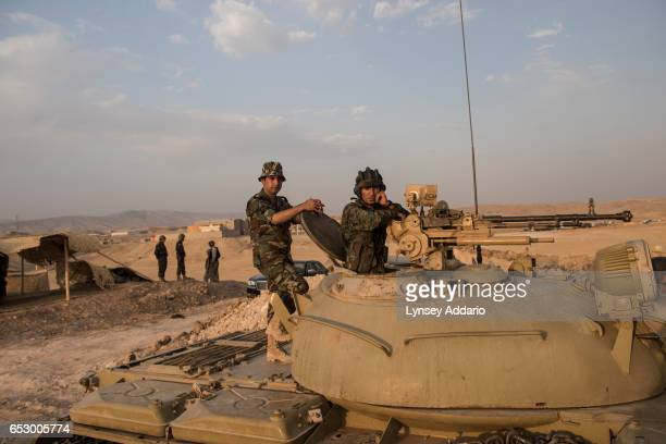 Kurdish Peshmerga forces stand in overwatch positions near the Mosul Dam close to Badriya in Northern Iraq August 18 2014 Iraqi officials said on...