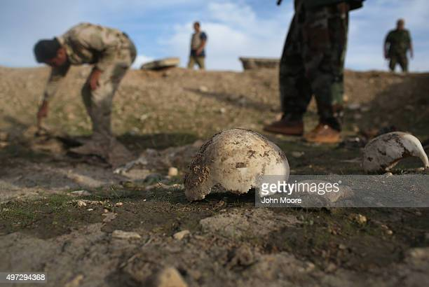 Kurdish Peshmerga show what they say is a mass grave of more than 50 Yazidis killed by ISIL on November 15 2015 in Sinjar Iraq Kurdish forces with...