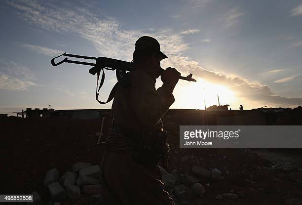 Kurdish Peshmerga soldier mans an observation post on the frontline with ISIS November 5 2015 near Telskuf in northern Iraq All of the town's 11000...