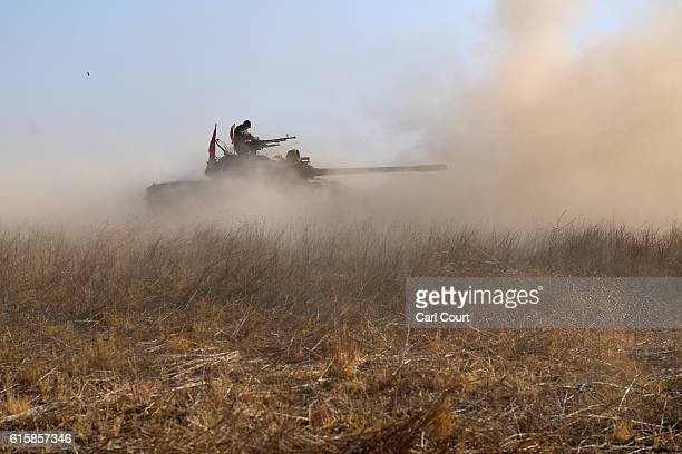 Kurdish peshmerga tank fires on an ISIS position during an assault to recapture the village of Tiskharab on October 20 2016 near Mosul Iraq Kurdish...