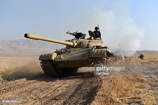 Kurdish peshmerga tank moves forward during an assault to recapture the village of Tiskharab on October 20 2016 near Mosul Iraq Kurdish and Iraqi...