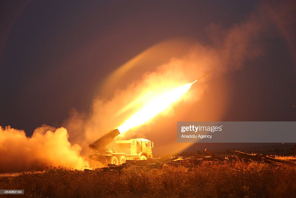 Kurdish Peshmergas bombing to area of Islamic State during the fight against IS militants to regain the control of the town of Celavle in Diyala province, Iraq, on August 24, 2014. Diyala's Celavle town invaded by IS militants on August 11 after then armed Peshmerga forces seize to regain the town.