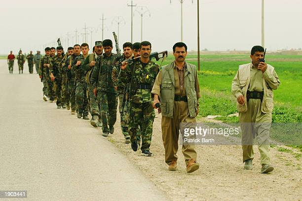 Kurdish Peshmergas militia and US Special forces advance from Erbil towards the road between Kirkuk and Mosul and cut it off April 6 2003 in Abushita...