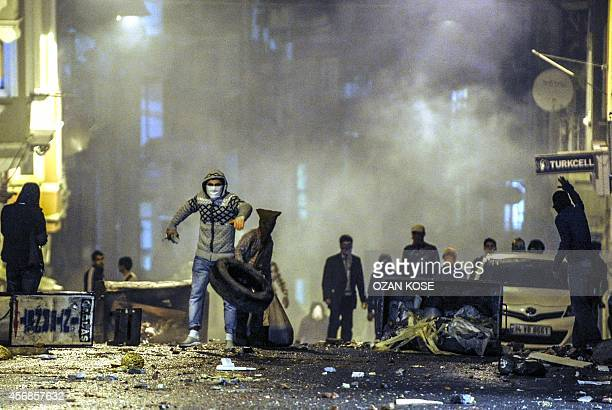 Kurdish protestors clash with Turkish riot policemen in Istanbul on October 8 2014 The Turkish army has deployed in the streets of Diyarbakir to...