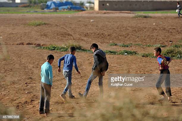 A Kurdish refugee boys play soccer in a refugee camp on October 26 2014 in the southeastern town of Suruc Turkey The Syrian town of Kobani has yet...