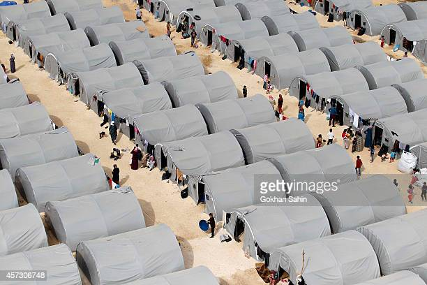 Kurdish refugees live in tents in a refugee camp on October 16 2014 in the southeastern town of Suruc Turkey According to a local official Islamic...