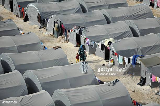Kurdish refugees live in tents in a refugee camp on October 26 2014 in the southeastern town of Suruc TurkeyThe Syrian town of Kobani has yet again...