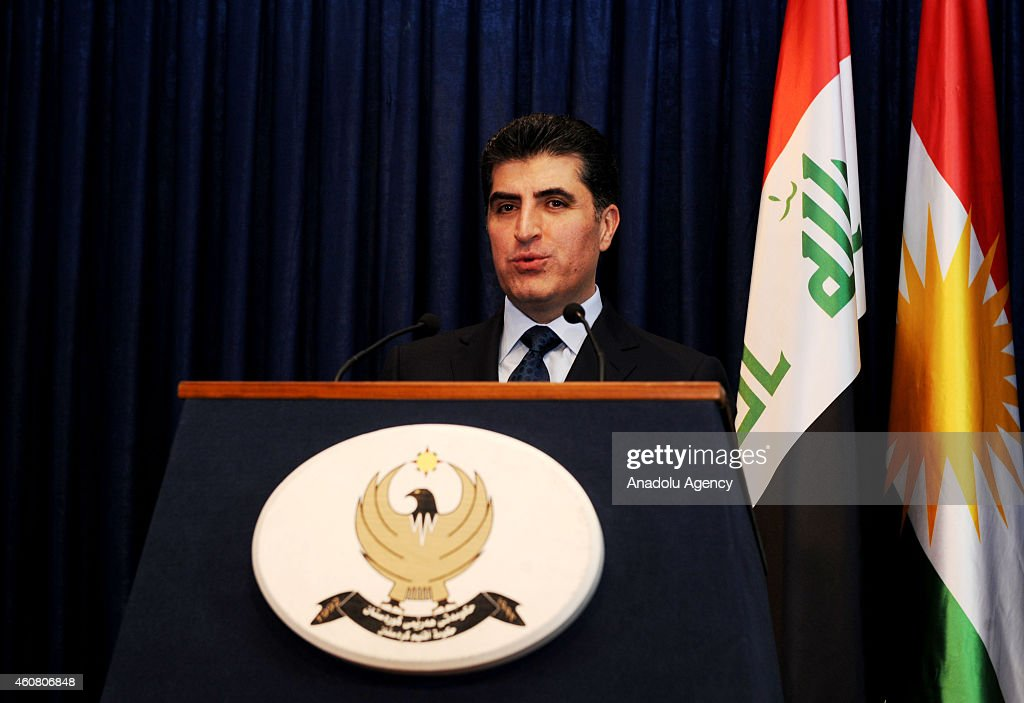 Kurdish Regional Government Prime Minister <a gi-track='captionPersonalityLinkClicked' href=/galleries/search?phrase=Nechirvan+Barzani&family=editorial&specificpeople=582951 ng-click='$event.stopPropagation()'>Nechirvan Barzani</a> and Italian Foreign Minister Paolo Gentiloni (not seen) attend a joint press conference following their meeting in Arbil, Iraq on December 23, 2014.