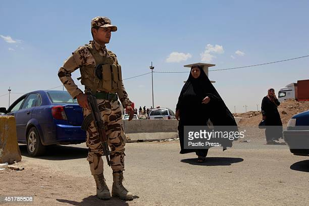 Kurdish security forces reinforce checkpoints due to the heavy influx of Iraqi displaced from cities like Mosul that have been attacked by the...