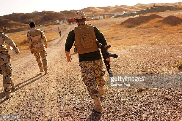 Kurdish soldiers with the Peshmerga keep guard near the frontline with Sunni militants on the outskirts of Kirkuk an oilrich Iraqi city on June 25...