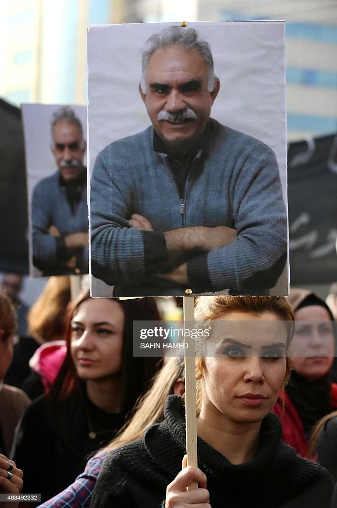 A Kurdish supporter of the Kurdistan Workers Party (PKK) holds a placard with a portrait of PKK's leader <a gi-track='captionPersonalityLinkClicked' href=/galleries/search?phrase=Abdullah+Ocalan&family=editorial&specificpeople=658599 ng-click='$event.stopPropagation()'>Abdullah Ocalan</a> during a demonstration calling for his release on February 15, 2015 outside the Turkish consulate in Arbil, the capital of the autonomous Kurdish in Arbil. Ocalan was captured by Turkish undercover agents in Kenya in 1999, brought back to Turkey and sentenced to death. His sentence was later commuted to life. AFP PHOTO / SAFIN HAMED