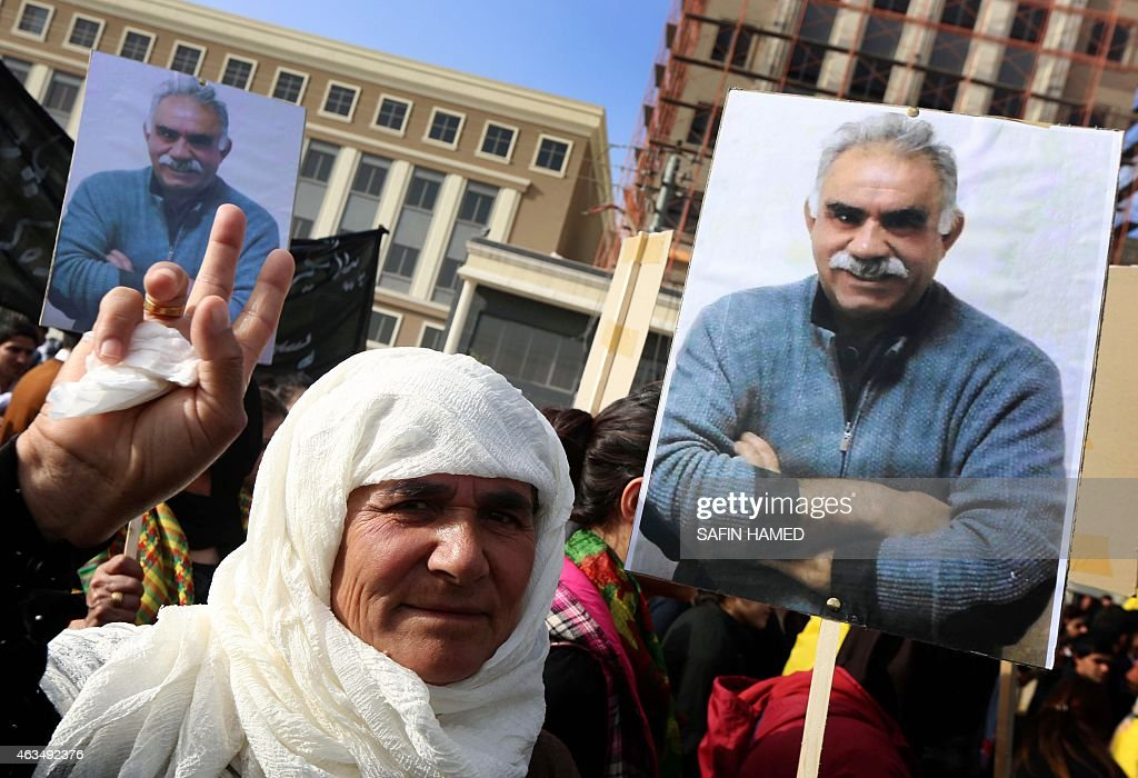 A Kurdish supporter of the Kurdistan Workers Party (PKK) holds a placard with a portrait of PKK's leader <a gi-track='captionPersonalityLinkClicked' href=/galleries/search?phrase=Abdullah+Ocalan&family=editorial&specificpeople=658599 ng-click='$event.stopPropagation()'>Abdullah Ocalan</a> during a demonstration calling for his release on February 15, 2015 outside the Turkish consulate in Arbil, the capital of the autonomous Kurdish in Arbil. Ocalan was captured by Turkish undercover agents in Kenya in 1999, brought back to Turkey and sentenced to death. His sentence was later commuted to life.