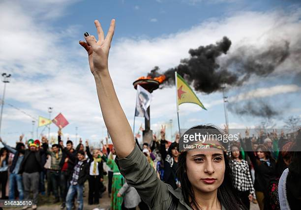 Kurdish woman flashes a vsign during Newroz celebrations on March 21 2015 in Diyarbakir Turkey Thousands of Kurds gather for the Newroz spring...