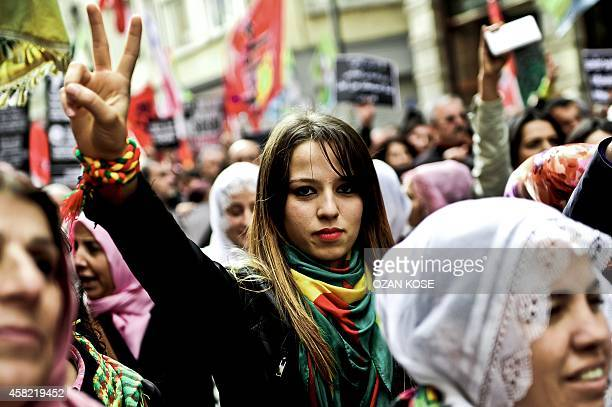 A Kurdish woman flashes the victory sign during a rally on November 1 2014 along Istiklal Avenue in Istanbul as part of an international day...