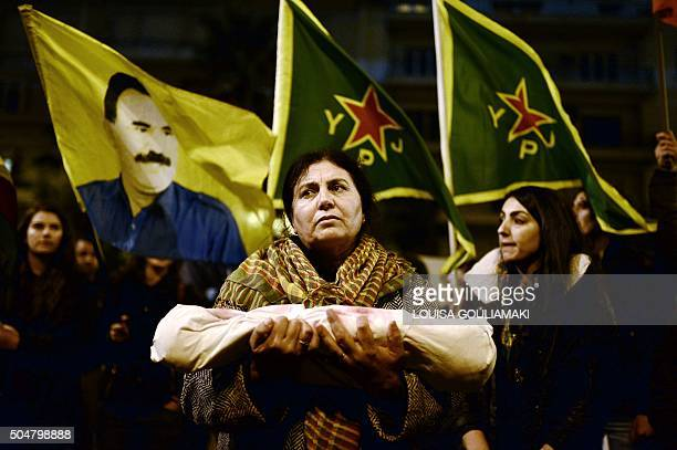 Kurdish woman holds a mock baby in a burial shroud during a demonstration outside the EU offices and the Turkish embassy in Athens on January 13...