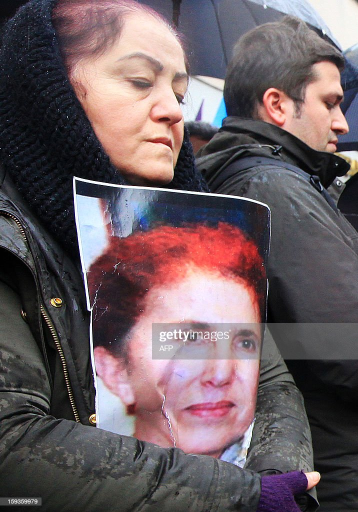 A Kurdish woman holds a portrait of Sakine Cansiz during a protest against the killings of three Kurdish women activists in France in front of the French Consulate in Istanbul on January 11, 2013. Demonstrators gathered at the French Consulate in Istanbul following the killings of three Kurdish women activists on 10 January, including Sakine Cansiz, a founding member of the militant Kurdistan Workers Party (PKK). Cansiz, who had been living in exile in France for years, was found dead in the early hours of 10 January in a Kurdish documentation centre on the first floor of an apartment building near Gare du Nord train station. Two other women - the president of the centre, Fidan Dogan, and Leyla Soylemez, also described as an activist - were also killed.
