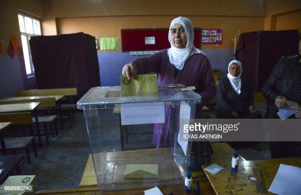 Kurdish woman votes in Turkey's tightlycontested referendum on expanding the powers of President Recep Tayyip Erdogan April 16 2017 in the center of...