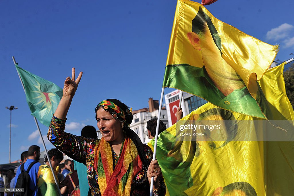 A kurdish woman waves a flag picture of PKK (Kurdistan Workers Party) jailed leader Abdullah Ocalan during a peace demonstration at Kadikoy, in Istanbul, on September 1, 2013. Many BDP (Peace and Democracy Party) supporters gathered in the district located on the Anatolian side of Istanbul to mark the Sepember 1 peace day. Turkish police blocked on September 1, 2013 the entrance to Istanbul's Gezi Park, the epicentre of anti-government protests in June, to prevent a demonstration there against a possible military intervention in Syria.