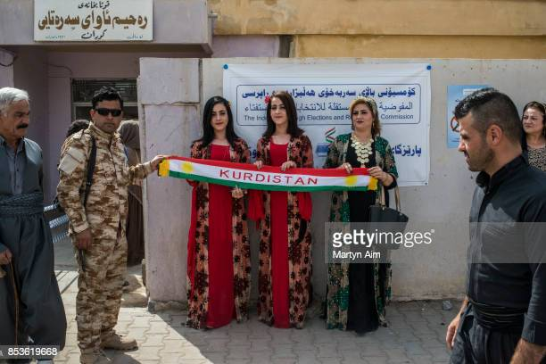 SEPTEMBER 25 Kurdish women hold a banner at a referendum to decide on independence from Iraq and the establishment of Kurdistan as a state on...