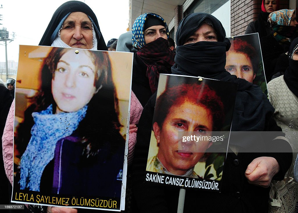 Kurdish women hold on January 12, 2013 portraits of the slain founding member of the Kurdistan Workers' Party (PKK), Sakine Cansiz (R), and Leyla Soylemez (L) during a protest in Diyarbakir against the killings of three Kurdish women activists in France. Kurdish women gathered two days after the killing of the three Kurdish women activists at the Paris Kurdistan Information Bureau. The PKK warned that it would hold France responsible if the killers were not quickly found, as Ankara said the slayings bore the hallmarks of an internal feud, noting that the victims appeared to have given the killer or killers access to the center.
