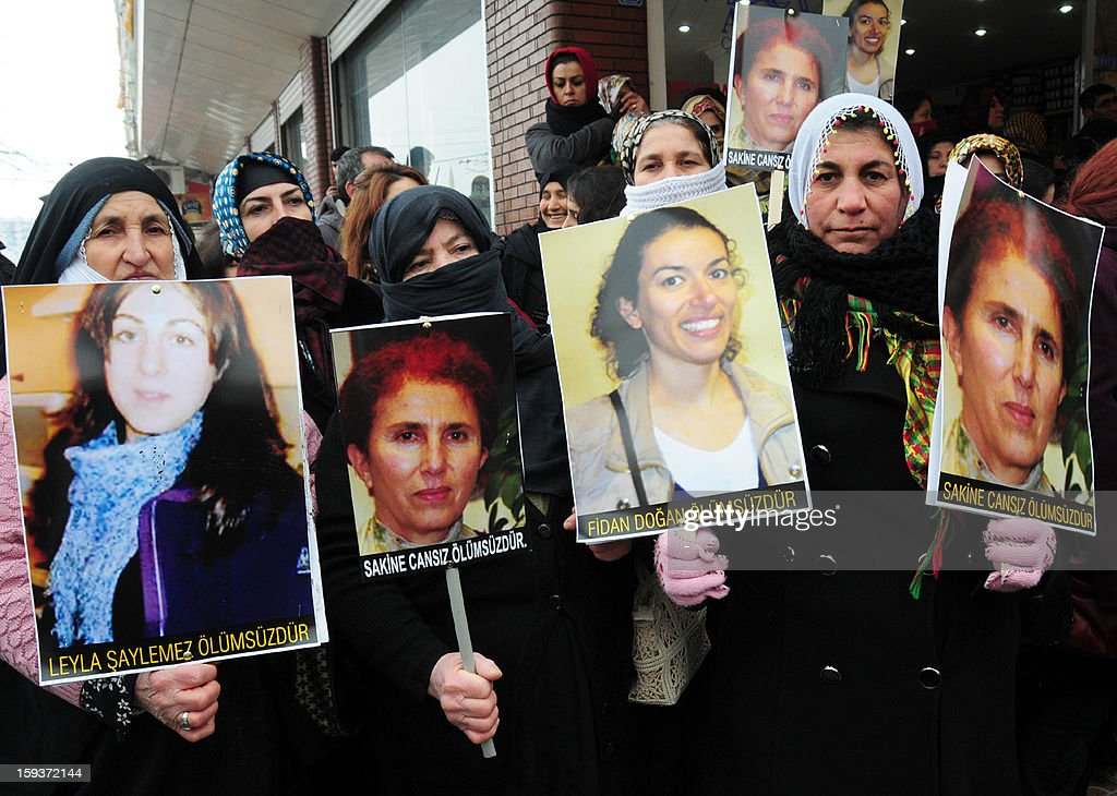 Kurdish women hold on January 12, 2013 portraits of the slain founding member of the Kurdistan Workers' Party (PKK), Sakine Cansiz (2nd L and R), Leyla Soylemez (L) and Fidan Dogan (2nd R) during during a protest in Diyarbakir against the killings of the three Kurdish women activists in France. Kurdish women gathered two days after the killing of the three Kurdish women activists at the Paris Kurdistan Information Bureau. The PKK warned that it would hold France responsible if the killers were not quickly found, as Ankara said the slayings bore the hallmarks of an internal feud, noting that the victims appeared to have given the killer or killers access to the center. AFP PHOTO/STR