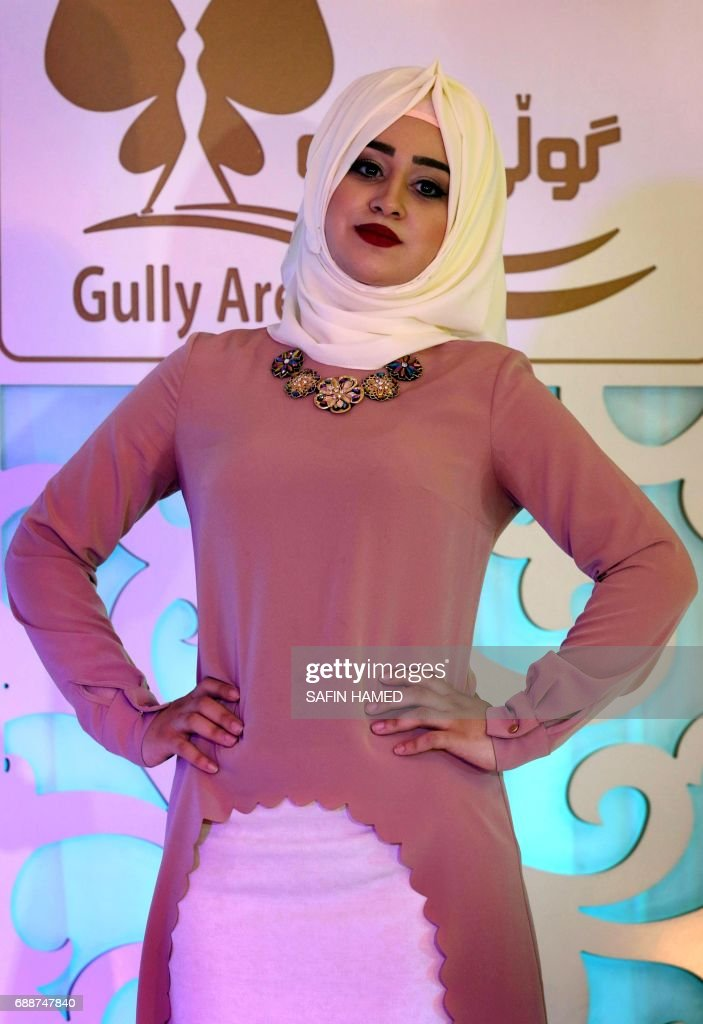 A Kurdish women walks down the runway during a Ramadan show for veiled women clothing in Arbil, the capital of the Kurdish autonomous region in northern Iraq, on May 26, 2017. More than 1.5 billion Muslims around the world will mark the month, during which believers abstain from eating, drinking, smoking and having sex from dawn until sunset.