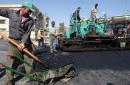 Kurdish workers build a road March 26 2002 in Suleimaniyeh part of the northern Iraq 'safe haven' controlled by the Patriotic Union of Kurdistan one...