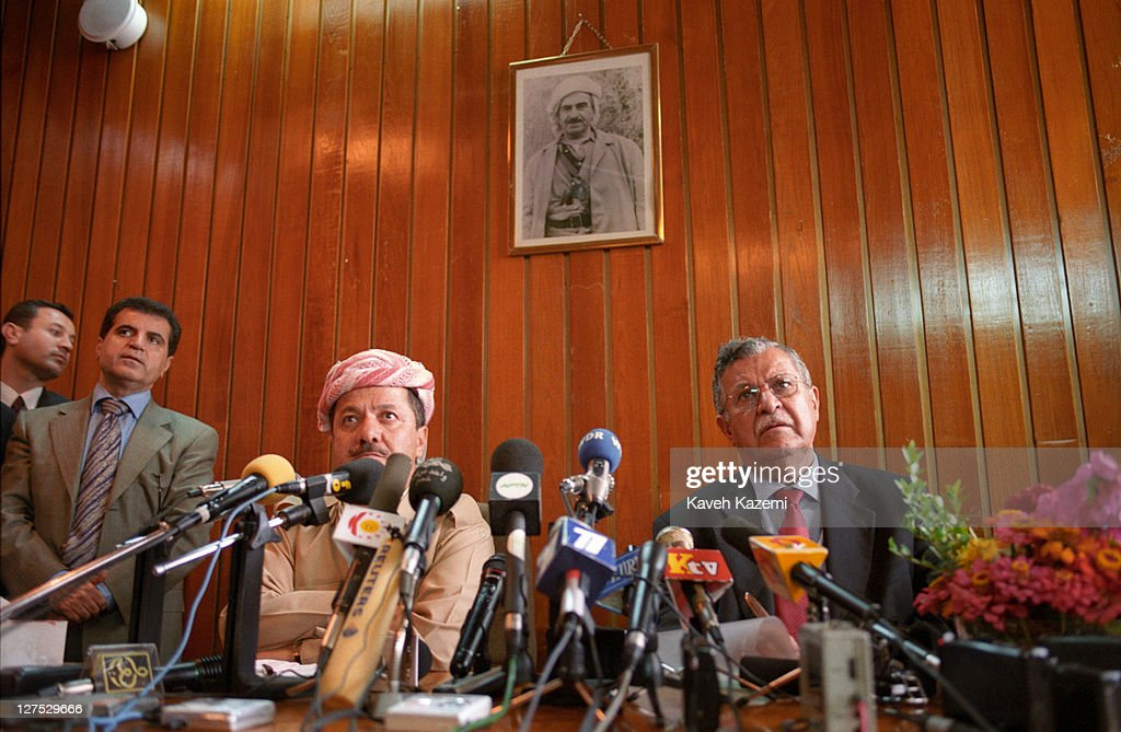 Kurdistan Democratic Party (KDP) leader <a gi-track='captionPersonalityLinkClicked' href=/galleries/search?phrase=Massoud+Barzani&family=editorial&specificpeople=240207 ng-click='$event.stopPropagation()'>Massoud Barzani</a> (left) and Patriotic Union of Kurdistan (PUK) leader <a gi-track='captionPersonalityLinkClicked' href=/galleries/search?phrase=Jalal+Talabani&family=editorial&specificpeople=213582 ng-click='$event.stopPropagation()'>Jalal Talabani</a> at a meeting of the Iraqi Kurdistan Parliament in Arbil, Iraq, 4th October 2002. The parliament endorsed a US-brokered deal between the two main Kurdish groups sharing control of northern Iraq, at its first session in six years, crowning peace moves amid US threats to oust the Baghdad regime.
