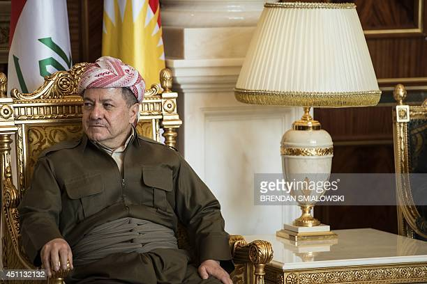 Kurdistan regional government president Massud Barzani listens to US Secretary of State John Kerry as he gives a statement to the press before their...