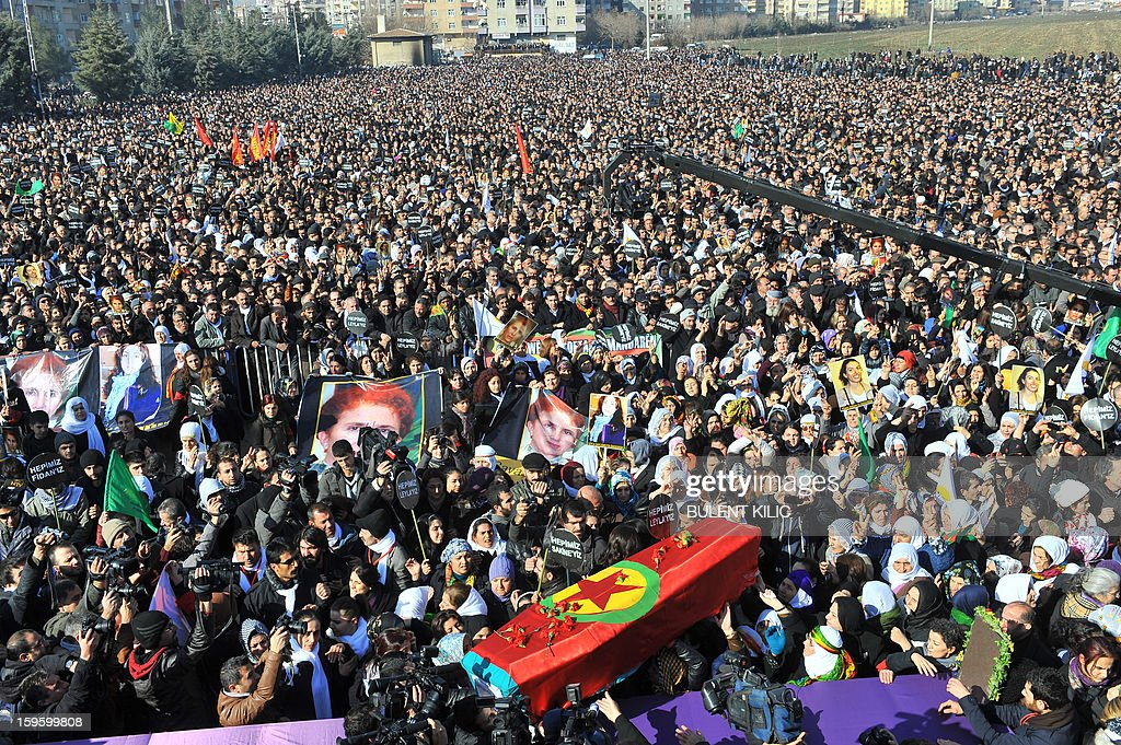 Kurds carry the coffins of the three top Kurdish activists Sakine Cansiz, Fidan Dogan and Leyla Soylemez, shot dead in the French capital, on January 17 in Diyarbakir. Several thousand Kurds gathered Thursday in a square in Diyarbakir, the main city of Turkey's Kurd-majority southeast, to pay a final tribute to three Kurdish women activists who were assassinated in Paris last week. The growing crowd of participants, men and women adorned in white scarves, a symbol of peace, marched in a funeral many in Turkey feared would turn into a violent protest. The three women, one of them Sakine Cansiz, a co-founder of the outlawed Kurdistan Workers' Party (PKK), were found fatally shot, at least three times in their heads, at a Kurdish centre in Paris last week. French police were hunting the unknown assailants.